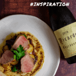 pork tenderloin and vegetables on a white plate - bottle of picardy chardonnay