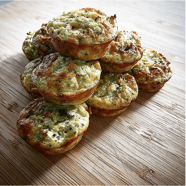 Cheesy vegetable muffins on chopping board
