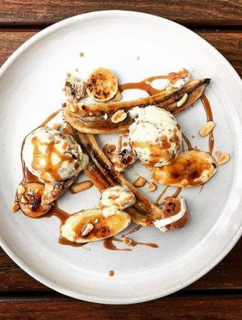 Hot cross bun & olive oil ice cream with bruleed bananas, salted caramel sauce, peanuts and croutons