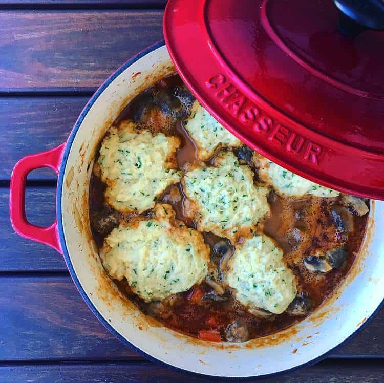 Scottish lamb stew with dumplings in chasseur pot