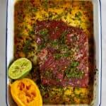 flap steak being marinated carne asada style