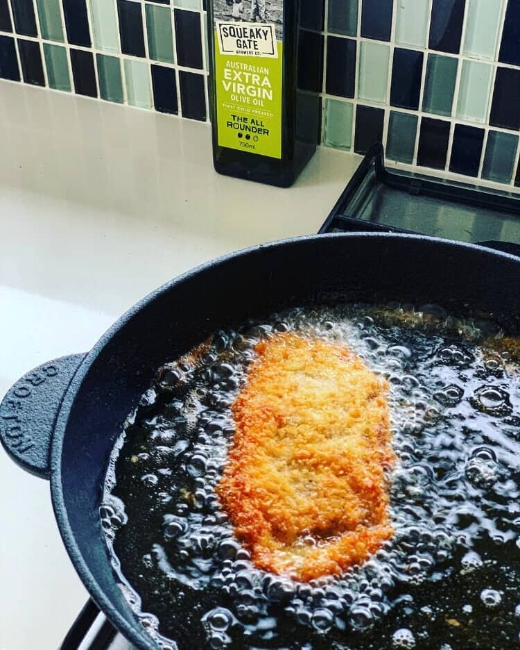 Veal parm frying in oil
