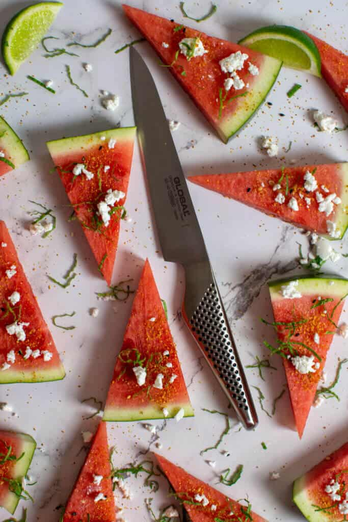 watermelon topped with togaroshi, mint & feta. Global GS-60 knife