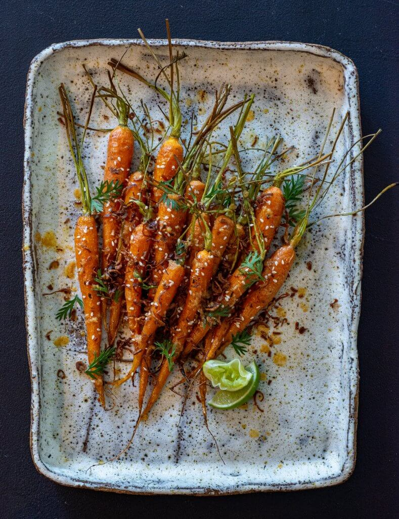 miso maple roased carrots on a serving platter
