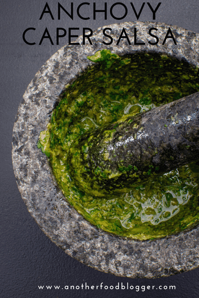 Anchovy steak sauce ingredients in a pestle & mortar