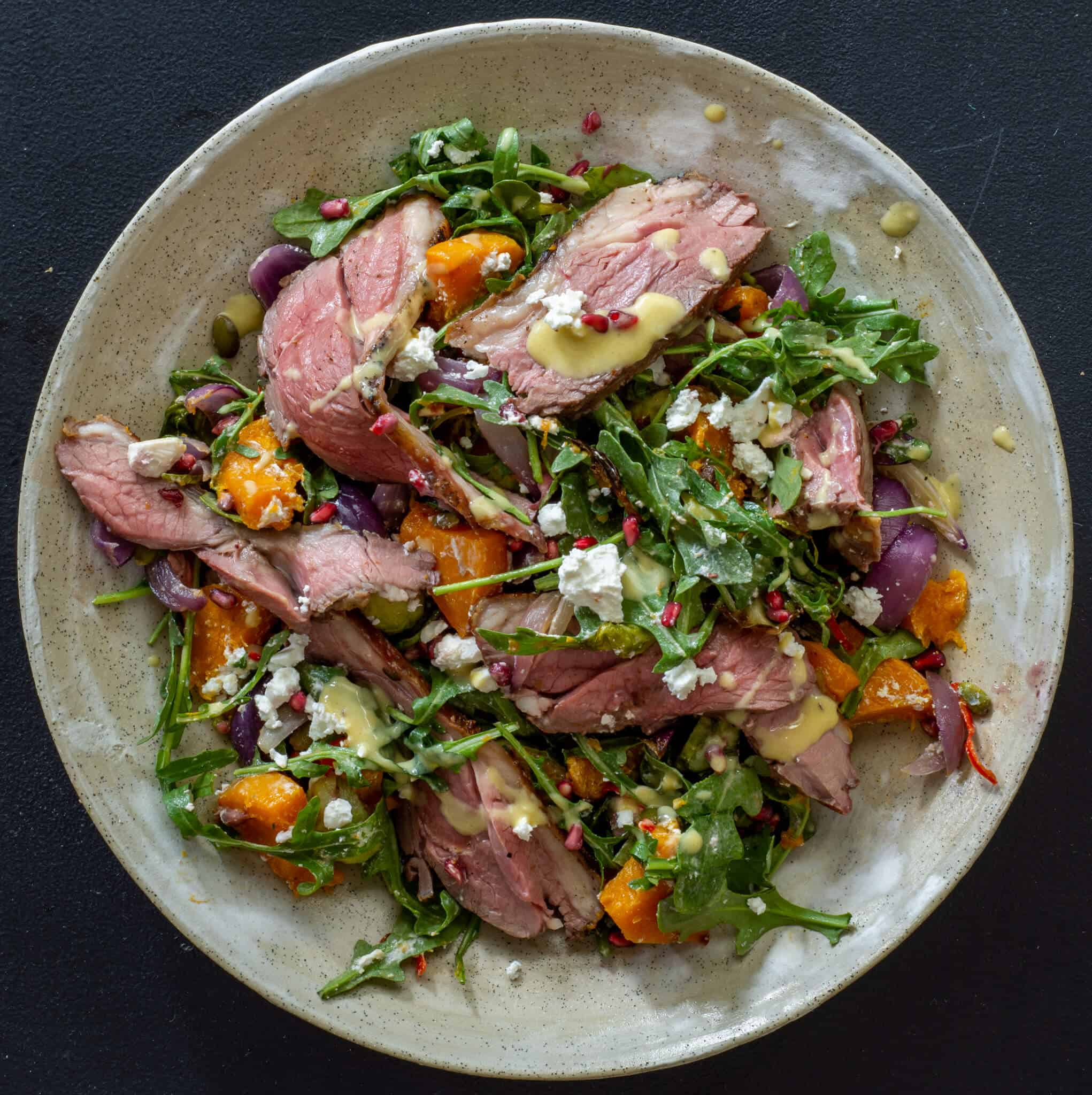 Grilled lamb & roasted veg salad in a bowl