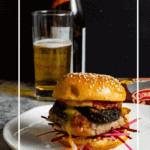 Pork & black pudding burger on a white plate with a beer in background