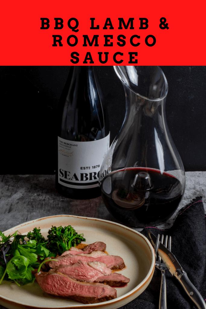 Seabrook wine shiraz, wine decanter, cooked lamb, macadamia romesco sauce & charred broccolini on a table
