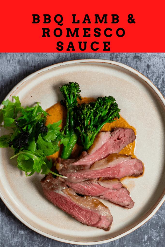 BBQ lamb, romesco sauce & charred broccolini on a plate