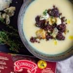Potato & leek soup with clonakilty black pudding next to it