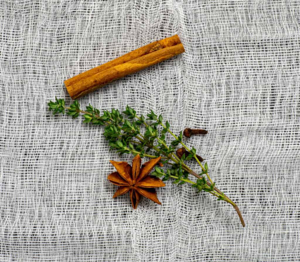 anise, clove, thyme & cinnamon on muslin cloth
