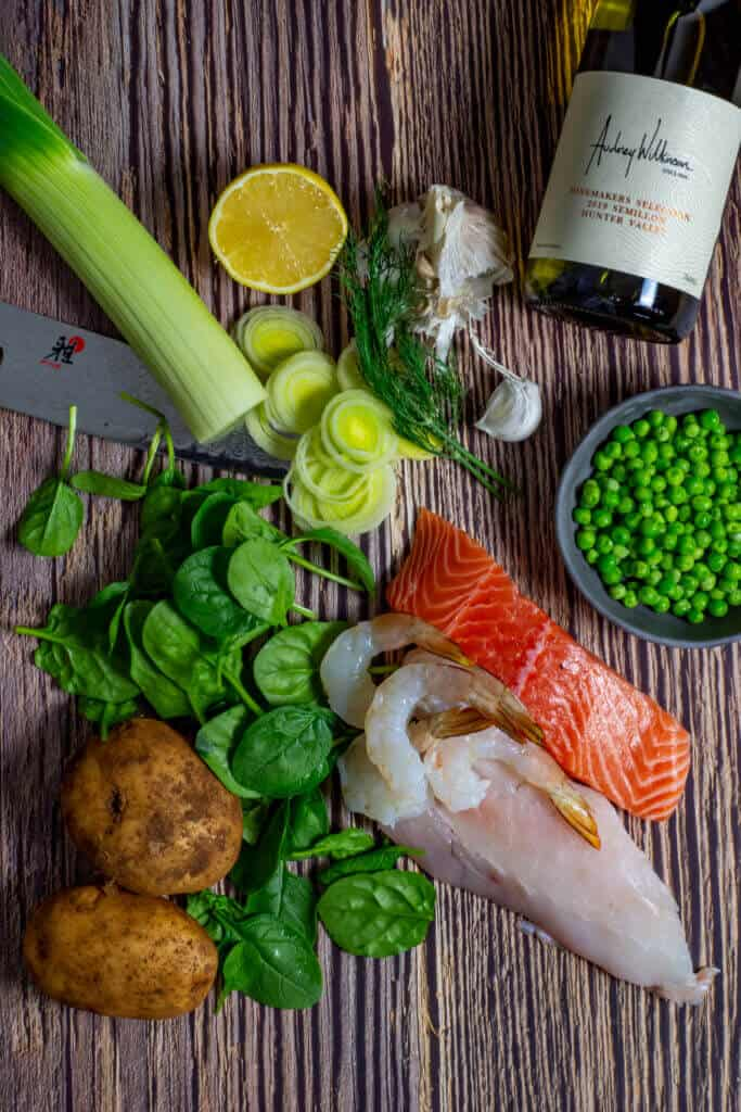Fish pie ingredients and a bottle of wine