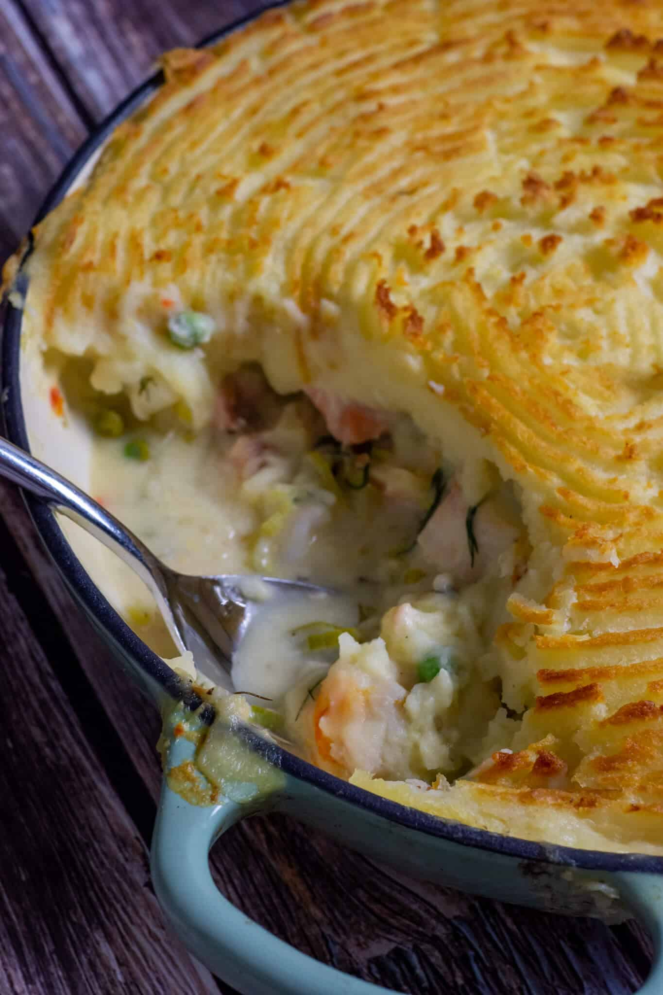 cooked fish pie on wooden board