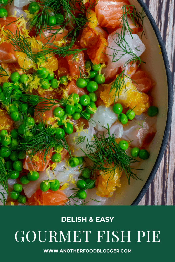 Raw fish, peas & dill in a pan for fish pie