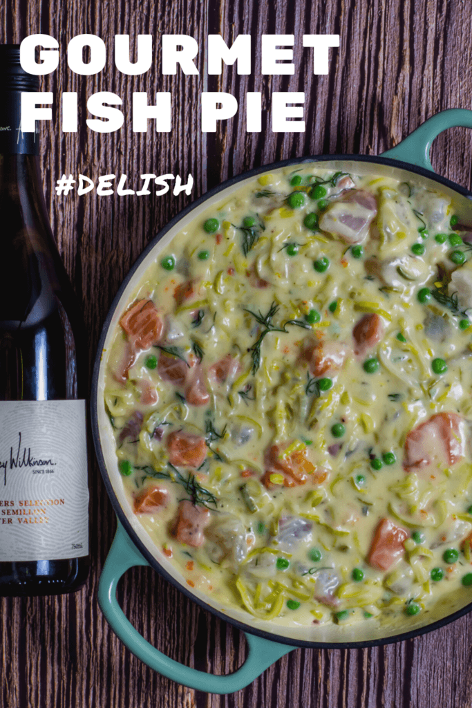 fish pie in pan with wine beside it