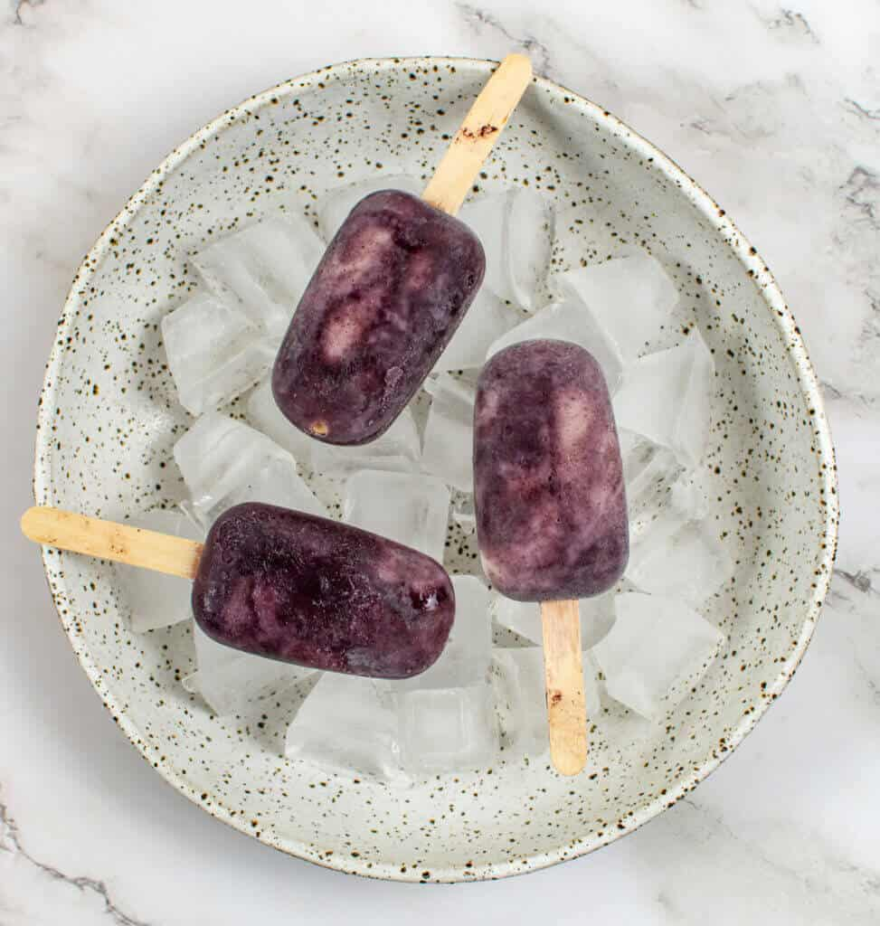 3 acai ice pops in a bowl of ice