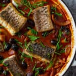 cooked spanish fish stew in casserole dish