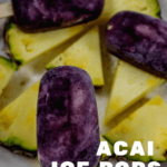 Acai ice pops on top of cut pineapple pieces