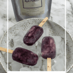 3 acai ice pops in a bowl of ice with packet of slofoodgrp acai