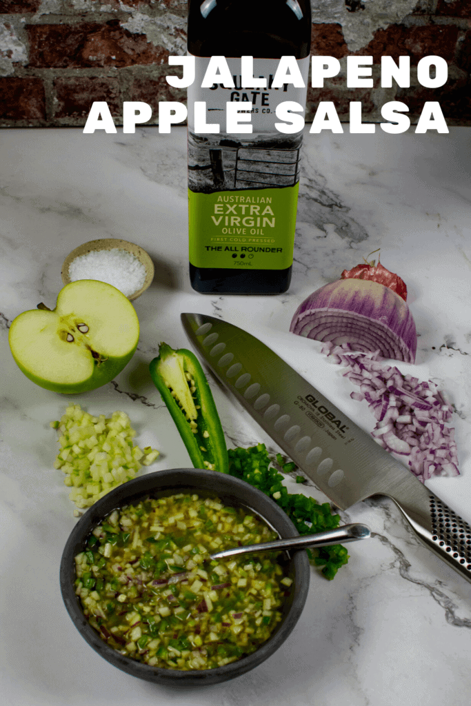 olive oil, apple, jalapenos, global chef knife & salsa on counter top