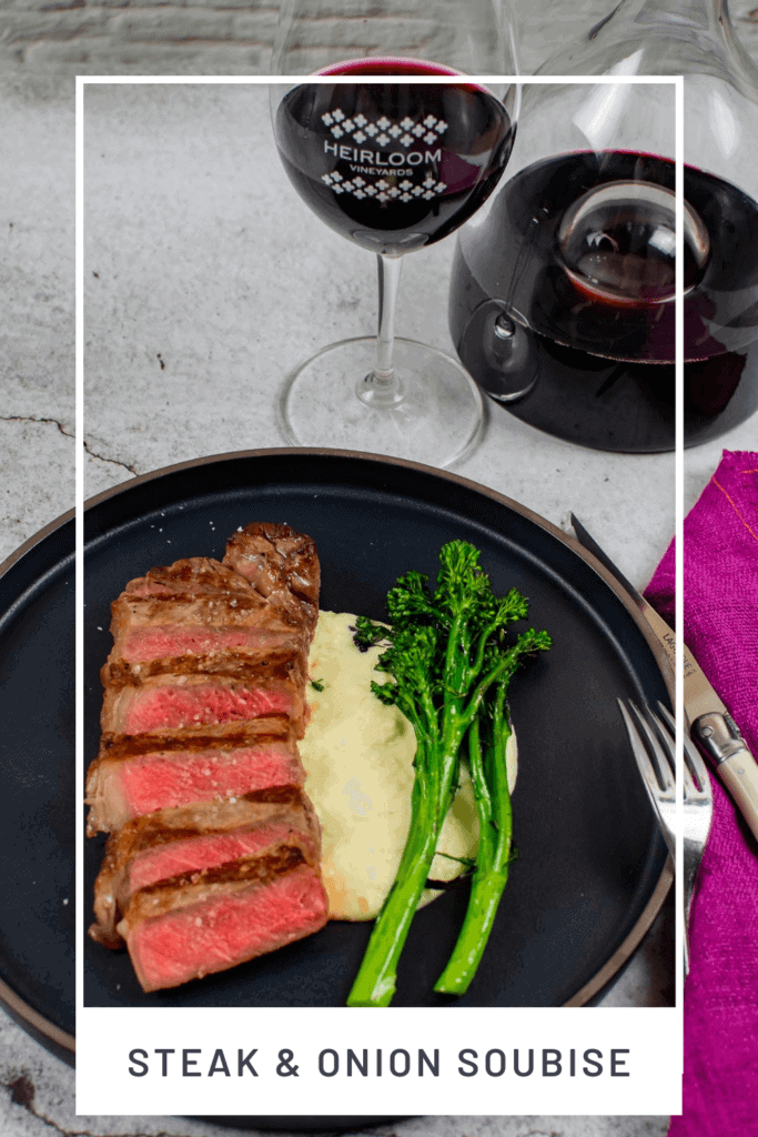 steak & onion soubise on a plate, decanter, glass of wine