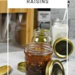 pickled raisins in kilner jar, global knived in background and sugar in a kilner jar