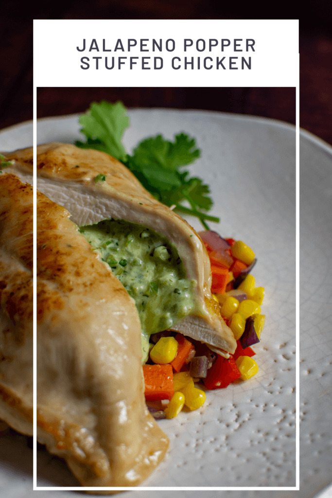 jalapeno popper stuffed chicken on white plate with corn hash