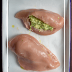 jalapeno popper stuffed chicken on a baking tray