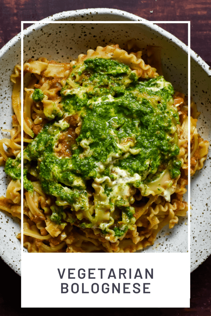 vegetable bolognese with basil pesto & creme fraiche in a bowl