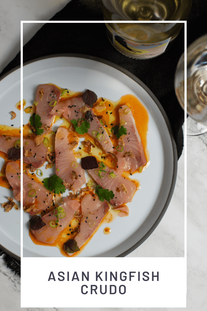 beautiful kingfish crudo on a CB2 plate, black napking and white gate wine co riesling