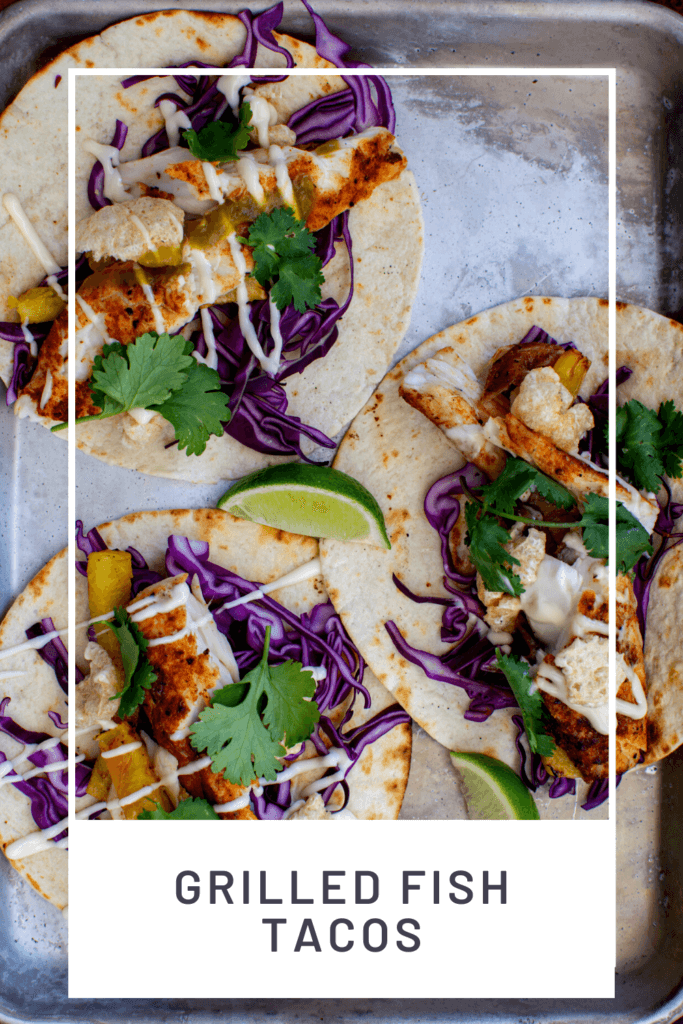 3 grilled fish tacos on a tray