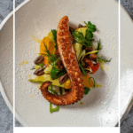 Grilled octopus salad on a white plate