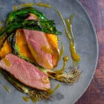 perfectly cooked duck breast, carrot puree & orange sauce on a made of australia plate