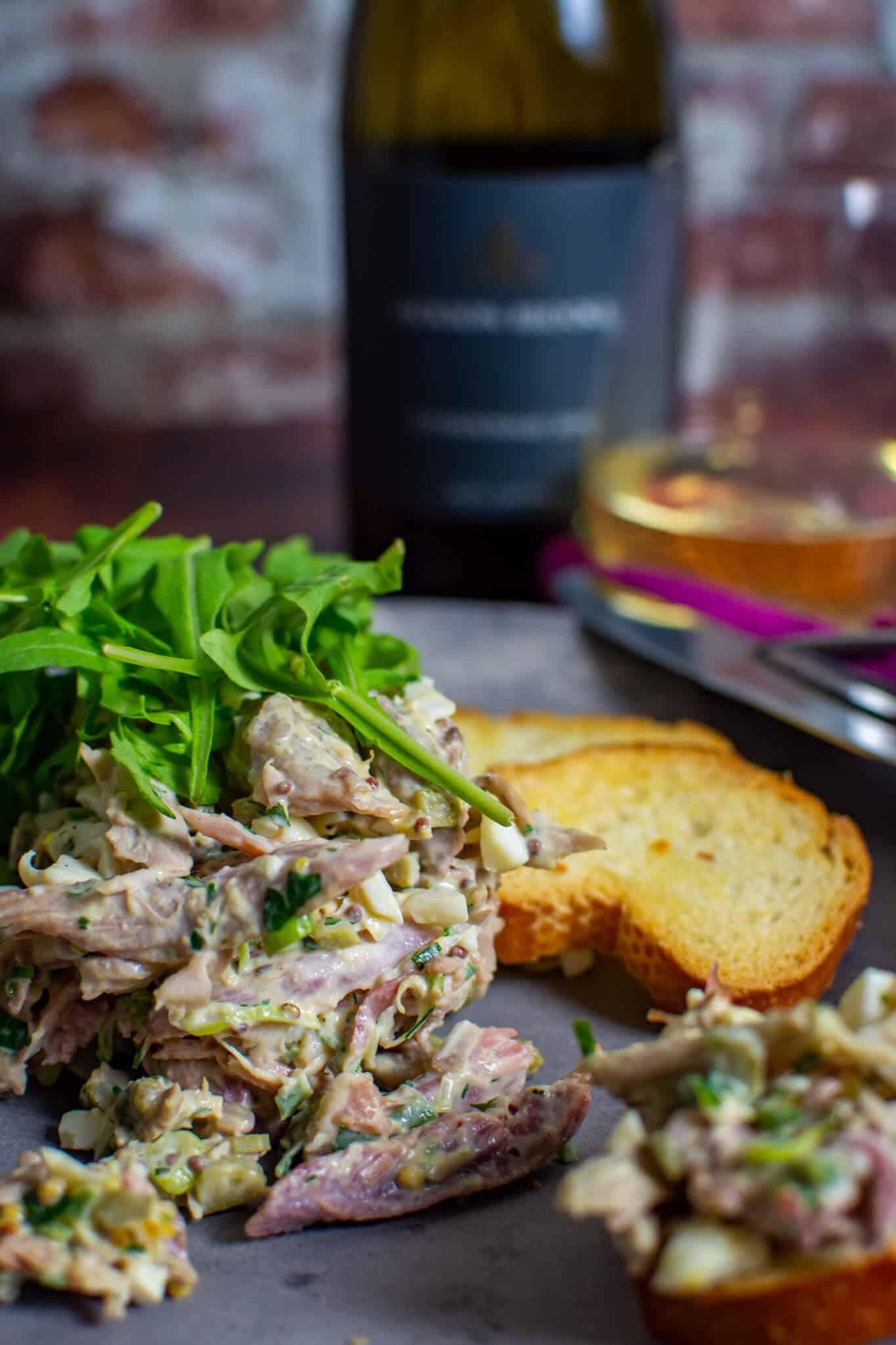 braised ham hock salad on a made of australia plate with jackson brooke chardonnay