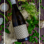 heirloom chardonnay, arborio rice & pea risotto ingredients on wooden table