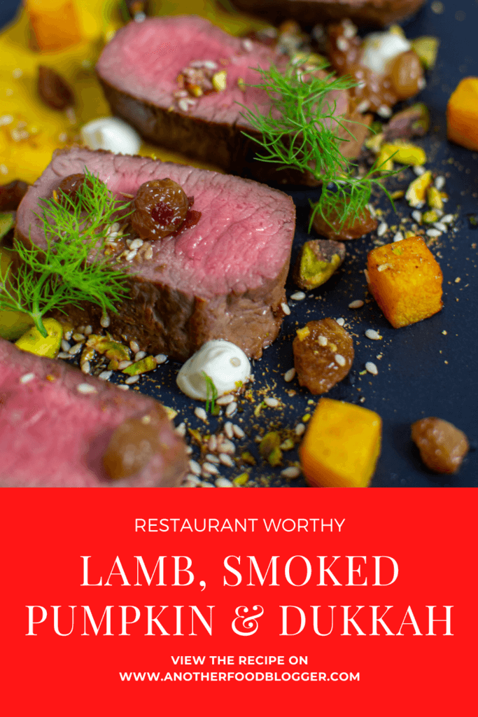 lamb, smoked squash puree, & pistachio dukkah on a black plate
