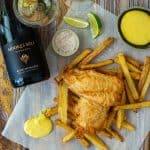 battered fish & chips, aioli, moores hill blanc de blanc wine & salt on a wooden table