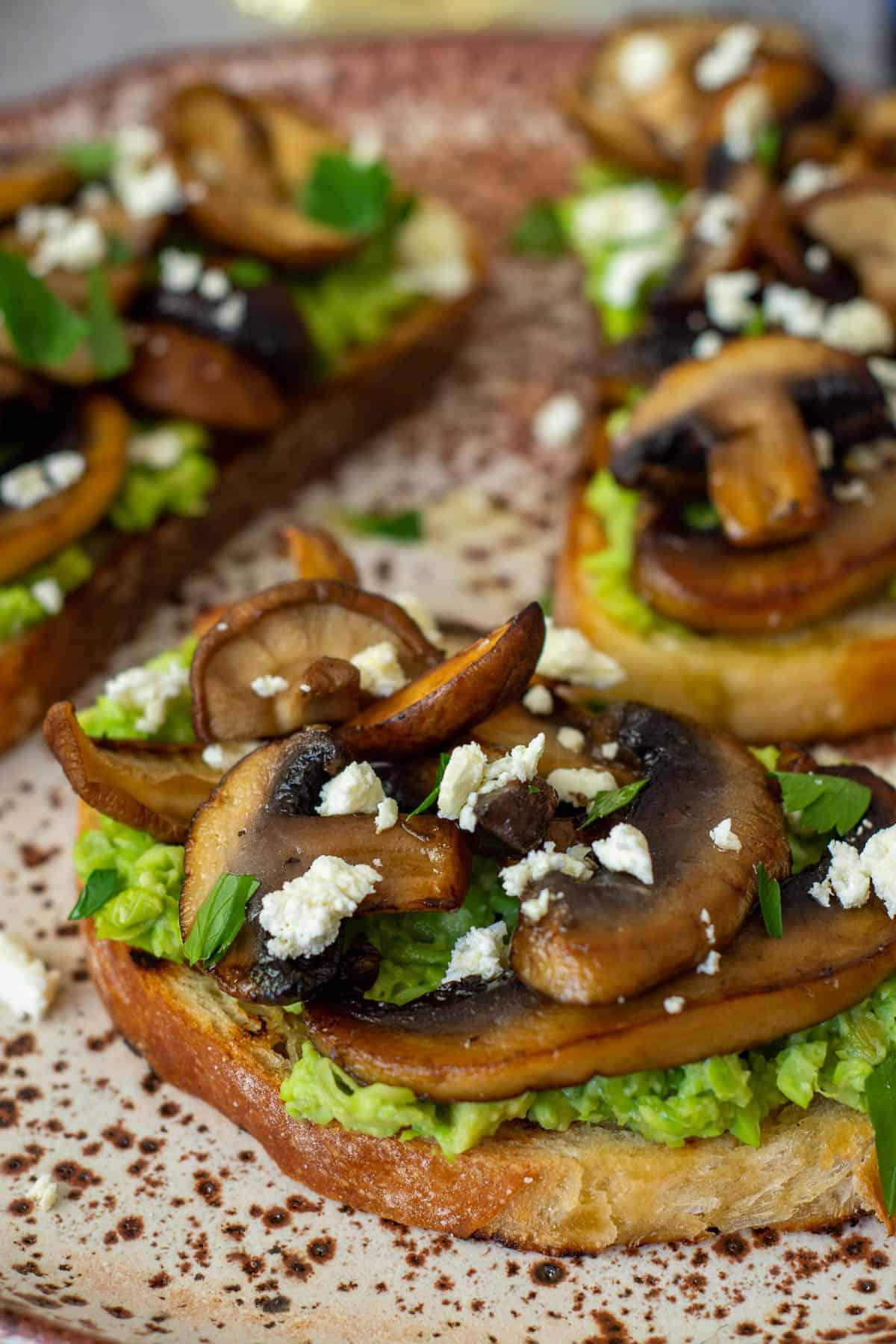 mushroom avocado toast on a plate