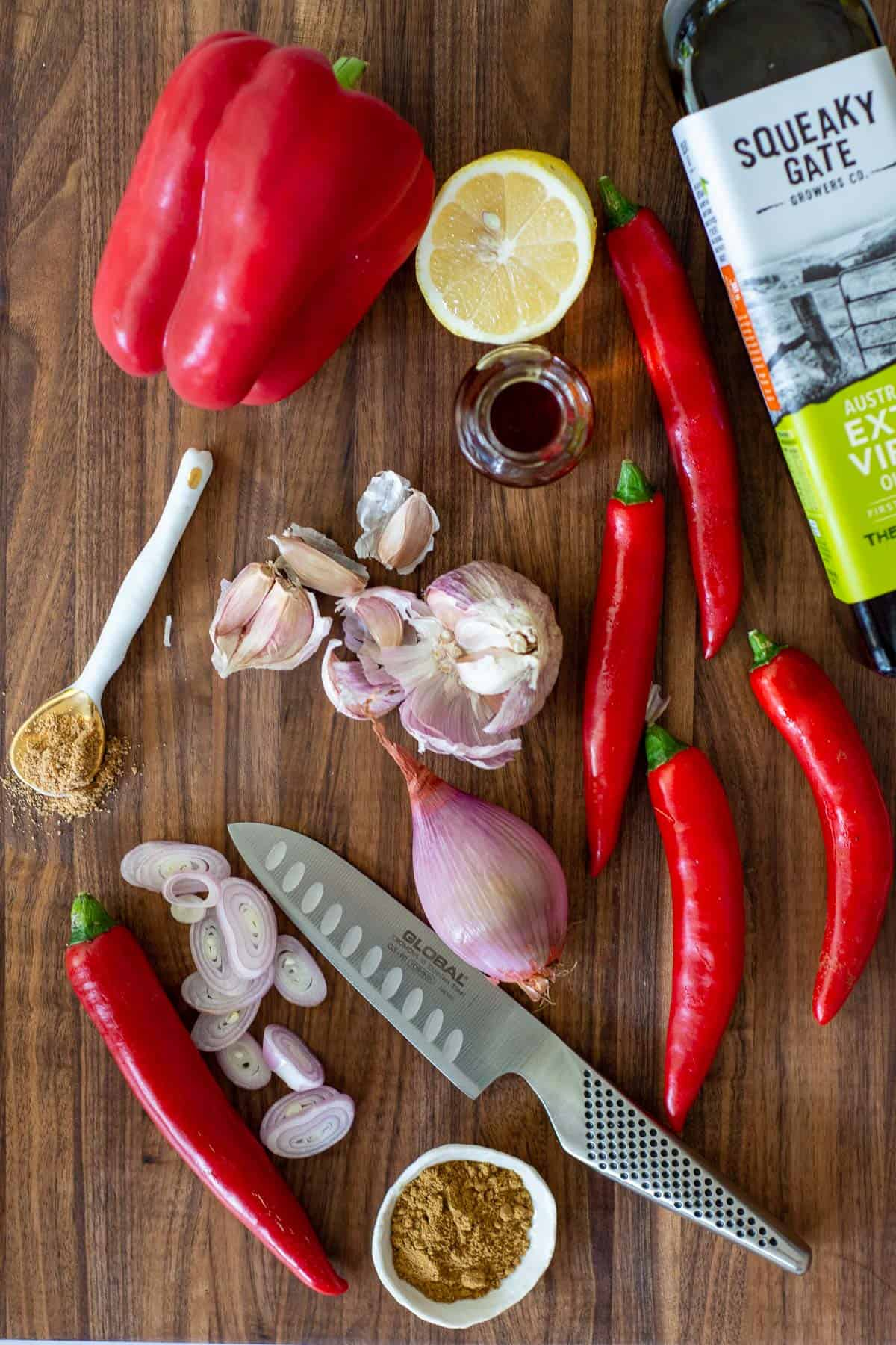 harissa ingredients on a chopping board and a global chef knife