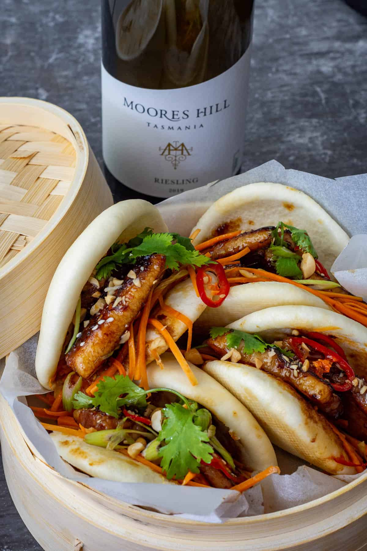 porn bao inside a bamboo steamer with moores hill riesling