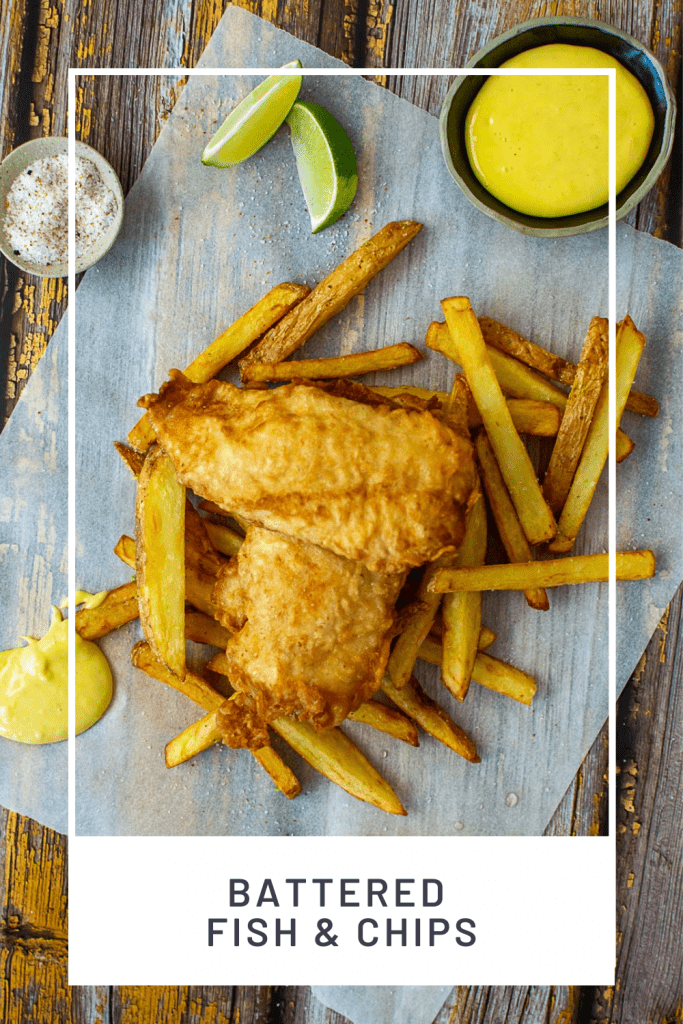 battered fish & chips, aioli & salt on a wooden table