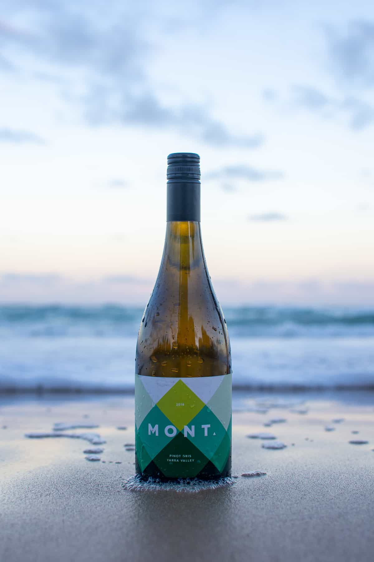 mont pinot gris bottle on the beach