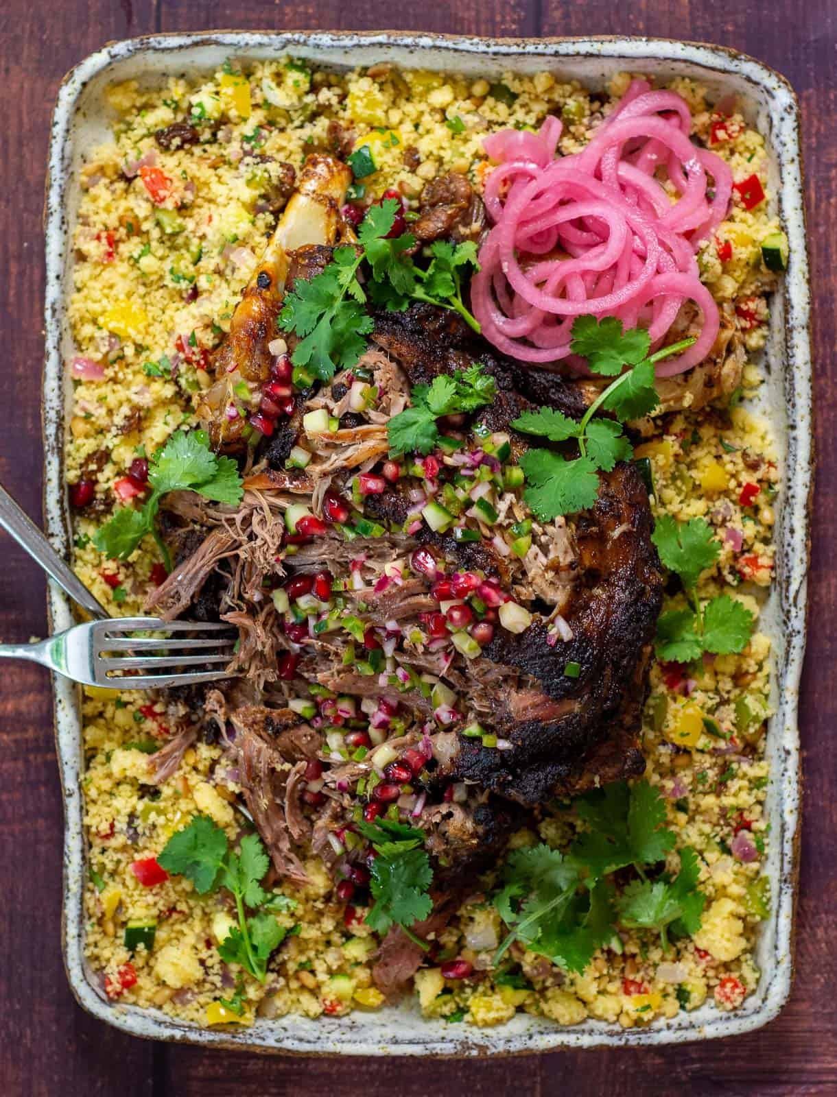 slow cooked moroccan lamb on a bed of couscous and pomegranate salsa