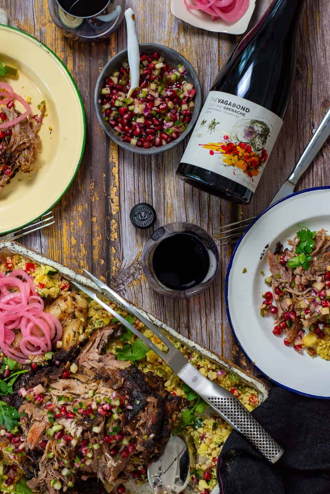 platter of slow cooked moroccan lamb, plates with food and bottle of thistledown vagabond grenache