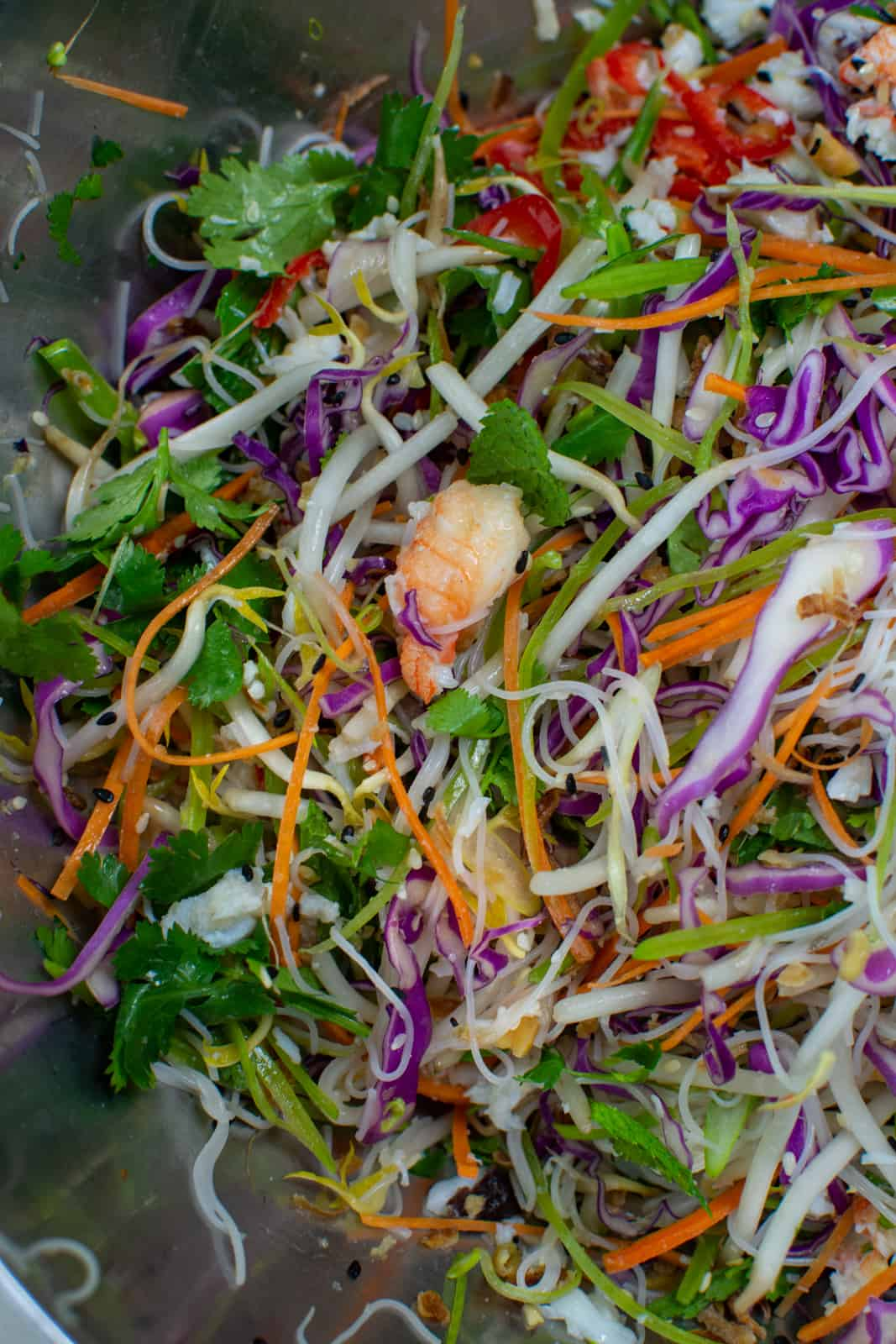 asian crab salad ingredients in a mixing bowl