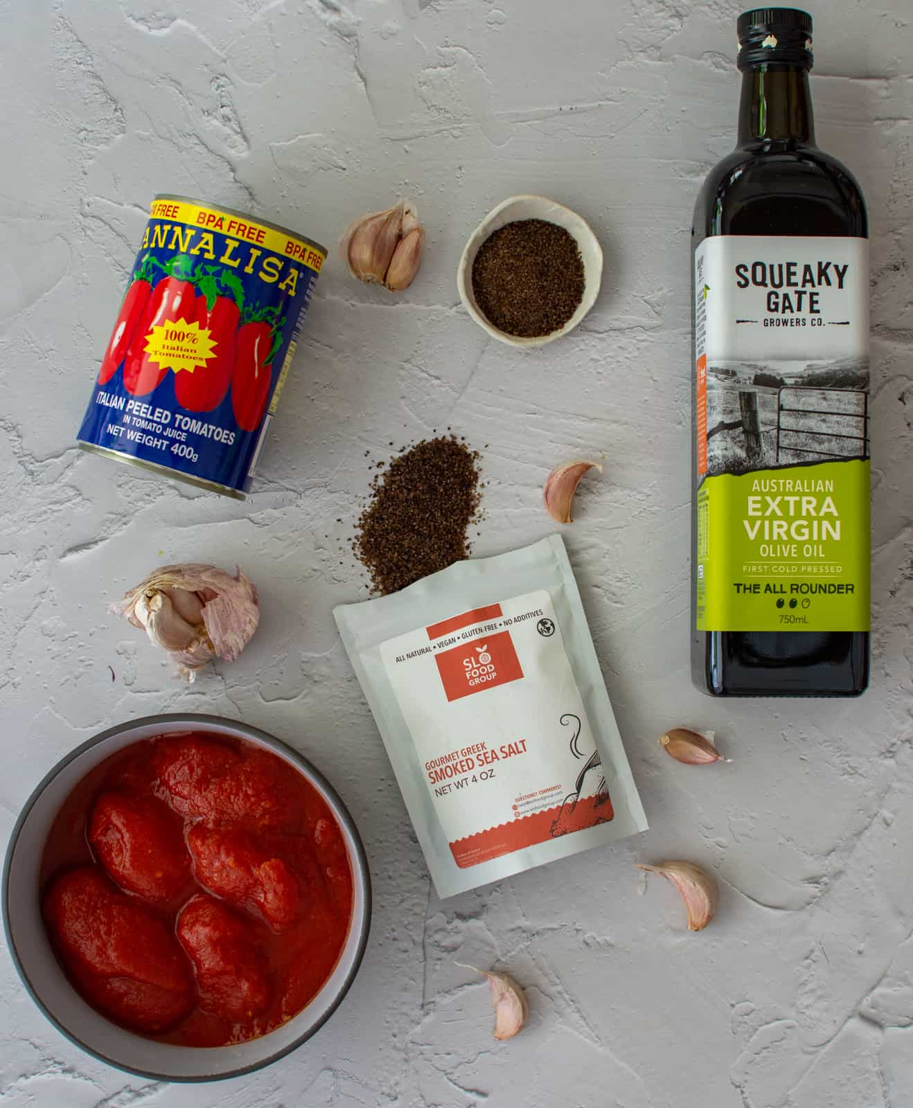 ingredients to make pizza sauce on a counter top