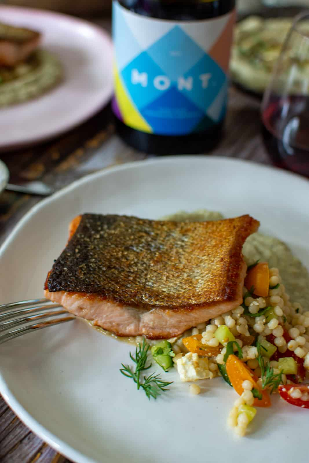 Crispy skin salmon on a bed of baba ghanoush & pearl couscous