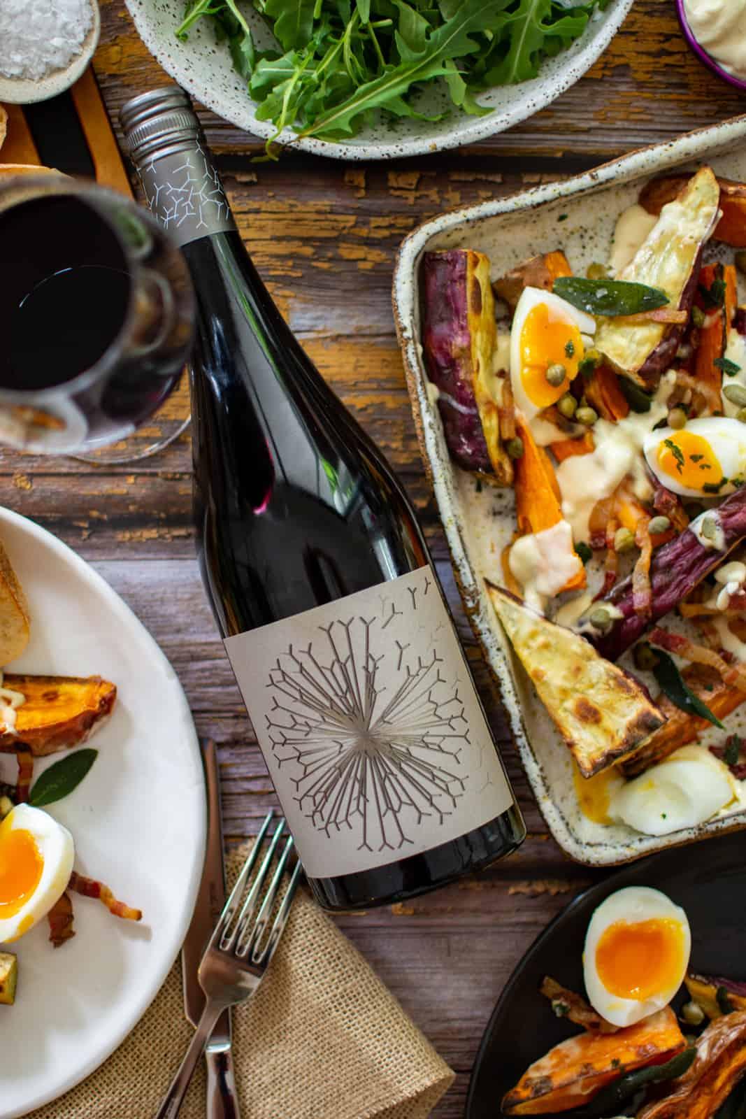 Dandelion vineyard wine and crispy roasted sweet potato salad on a plate