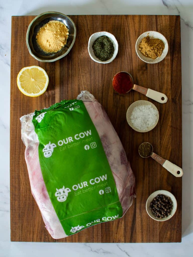 Our cow lamb shoulder and spices on a global chopping board