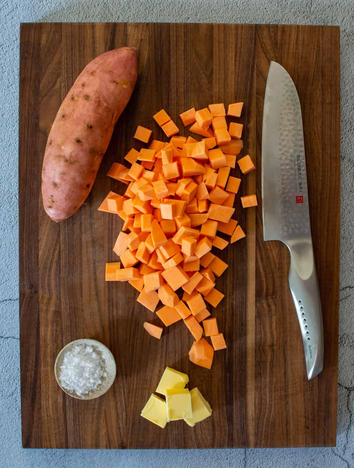 sweet potatoes & globa chef knife on chopping board